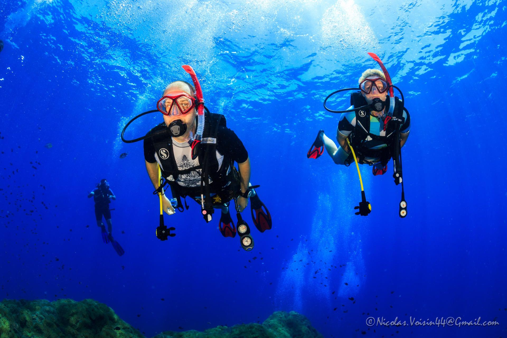 Scuba diver couple in Thailand diving at Sailrock